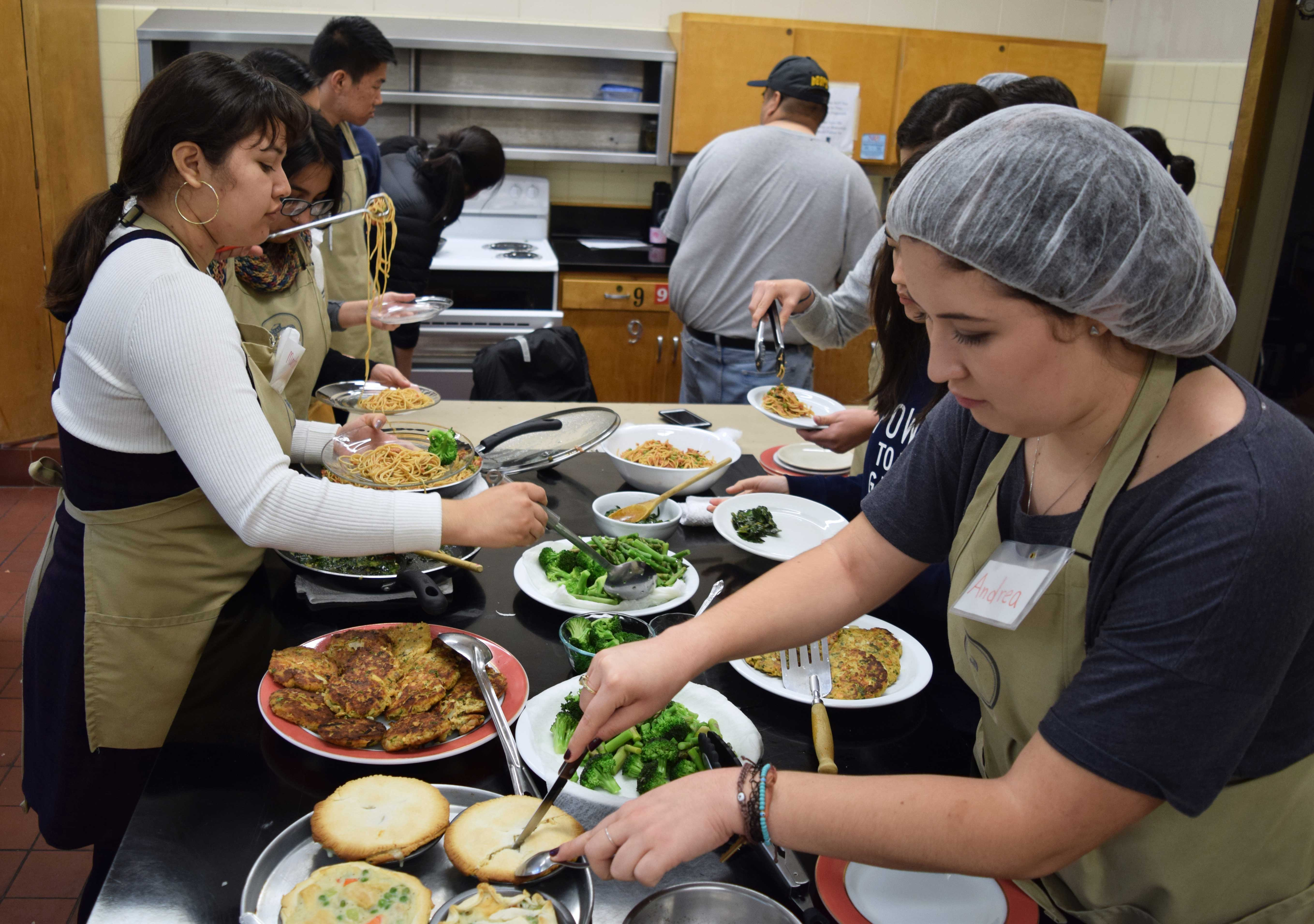 Students cooking in the UC Berkeley teaching kitchen.
