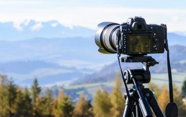 A camera taking a photo of a scenic landscape