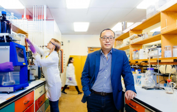 Dan Nomura standing in his lab